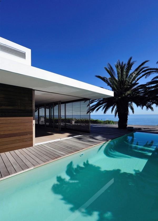 Planos de diseño moderno en residencia africana con piscina