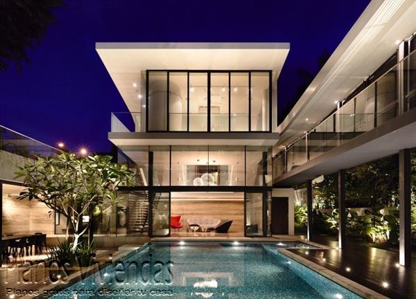 Construcción de casa moderna sobre terreno ondulado en Singapur (10)