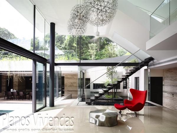 Construcción de casa moderna sobre terreno ondulado en Singapur (11)