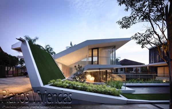 Construcción de casa moderna sobre terreno ondulado en Singapur (2)