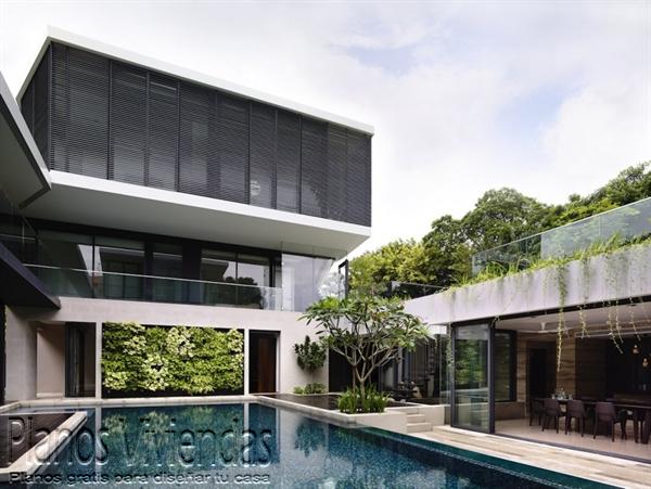Construcción de casa moderna sobre terreno ondulado en Singapur (6)