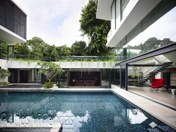 Construcción de casa moderna sobre terreno ondulado en Singapur (7)