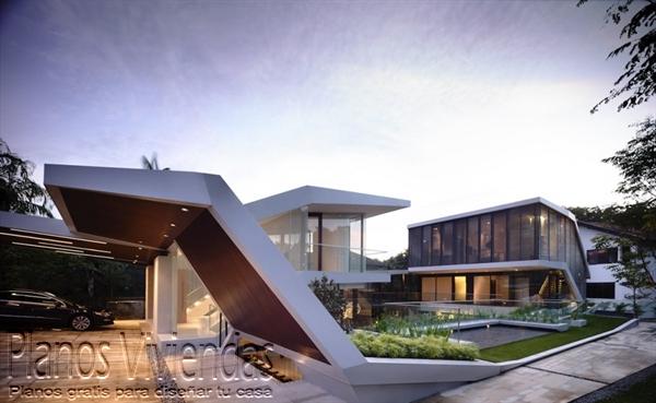 Construcción de casa moderna sobre terreno ondulado en Singapur (1)