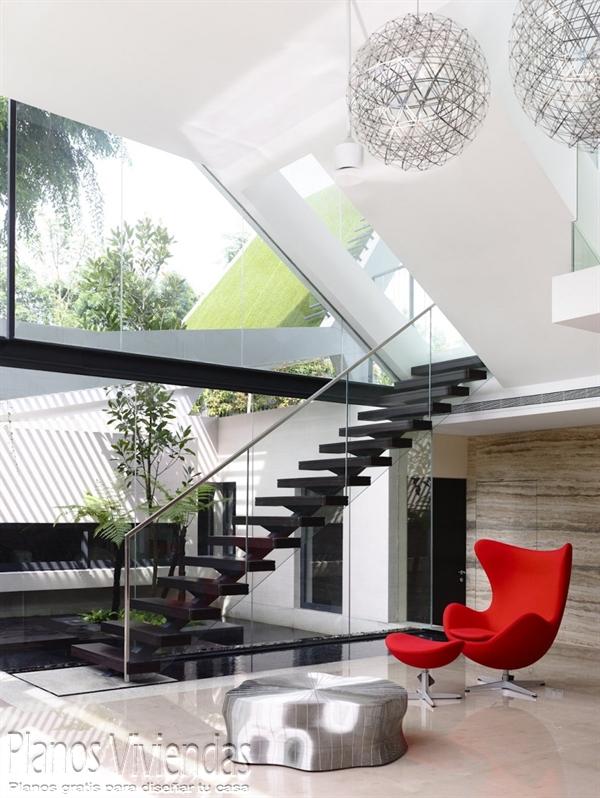 Construcción de casa moderna sobre terreno ondulado en Singapur (12)