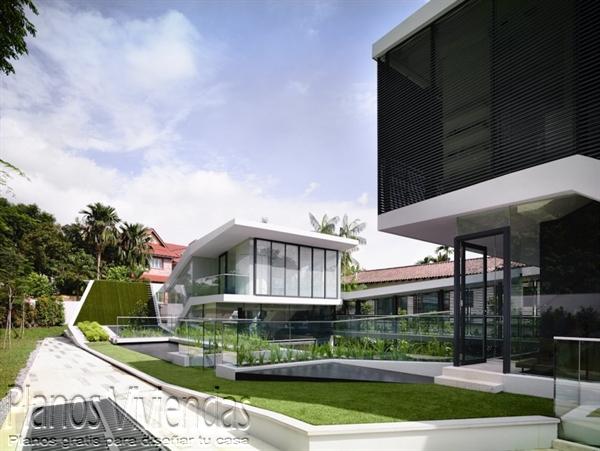 Construcción de casa moderna sobre terreno ondulado en Singapur (3)