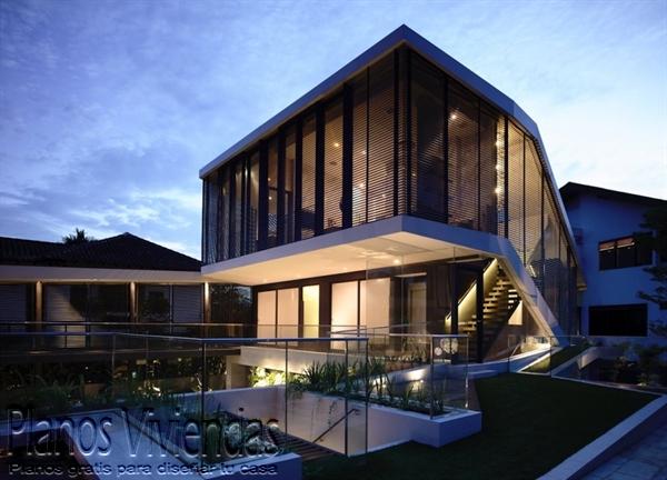 Construcción de casa moderna sobre terreno ondulado en Singapur (5)