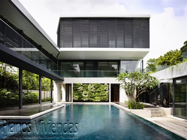 Construcción de casa moderna sobre terreno ondulado en Singapur (9)