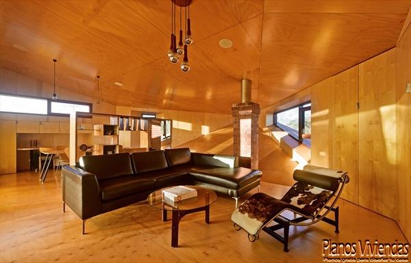 Interiores de la sala y cocina en la Casa 31_4 Room House (3)
