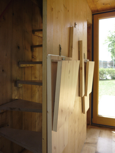 Planos de casa unipersonal de madera con tres pisos